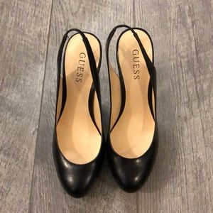 Black platform sling back pumps by Guess